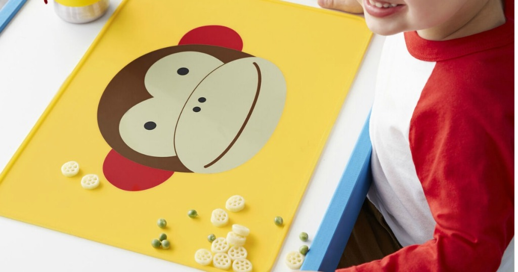 yellow placemat with a monkey on it with food on it