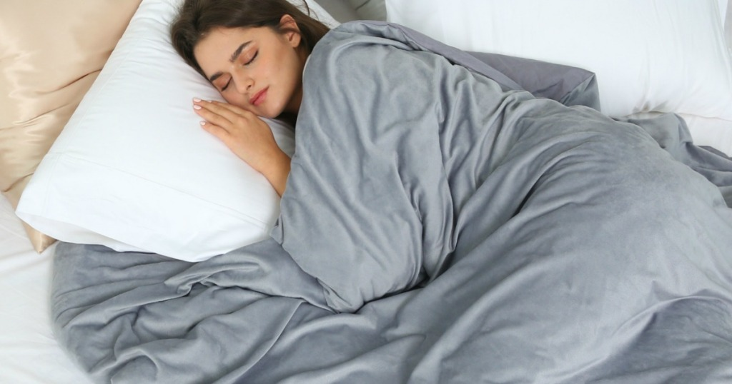 woman sleeping under Sleep Mantra Weighted Blanket