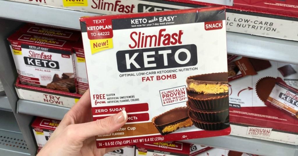 Box of SlimFast KETO Snacks in box in hand in-store