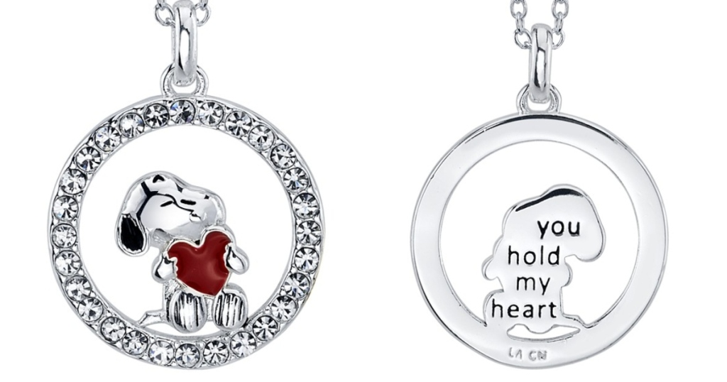 two images of a silver snoopy necklace. The first is the front with snoopy holding a red heart in a diamond circle, the back has a sweet message engraved