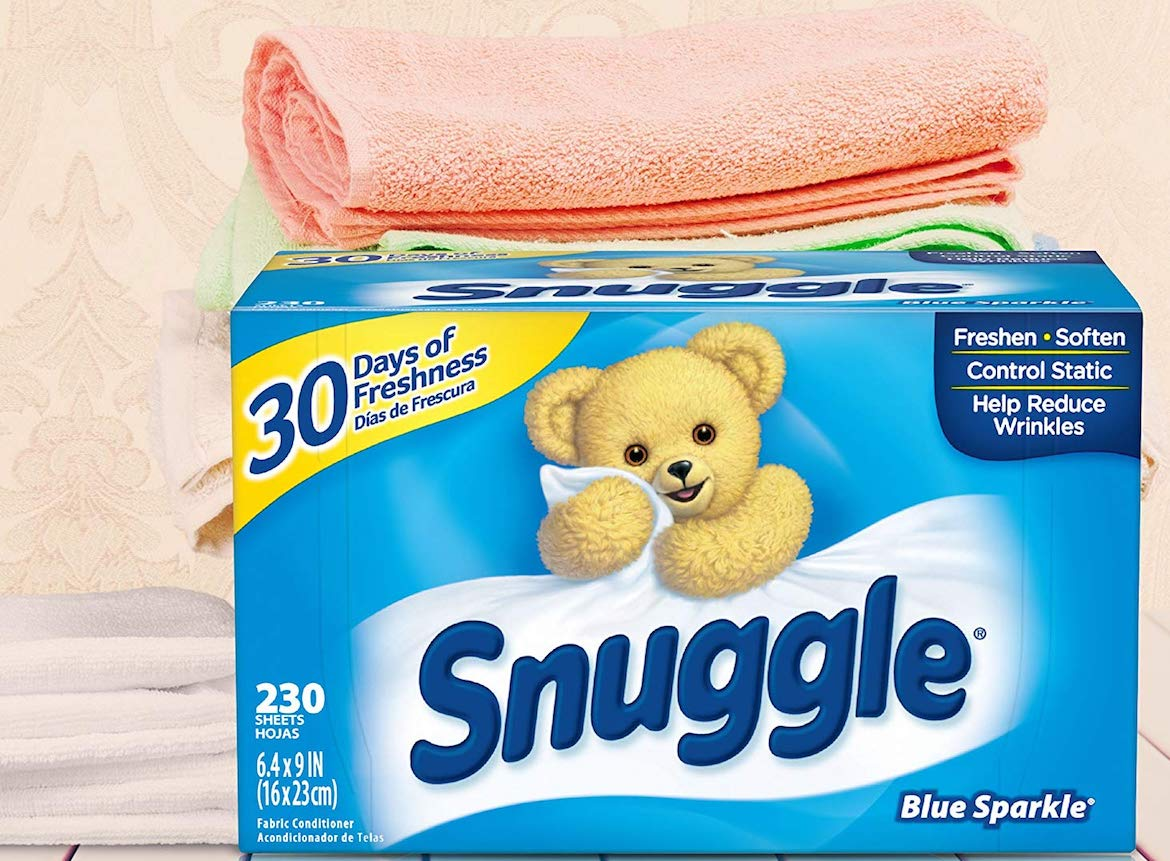 Snuggle Blue Sparkle Dryer Sheets sitting in front of stack of towels