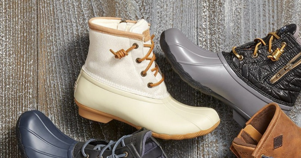 Women's boots laid out - including a white pair with fur lining