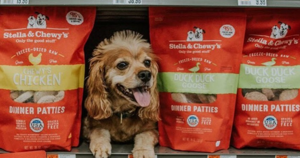 dog on store shelf with stella & chewy's dinner patties bags next to it
