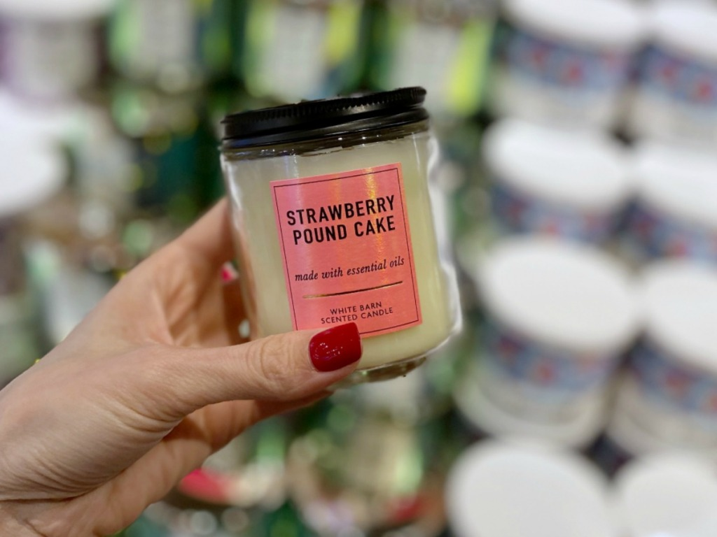 Woman holding Bath & Body Works Strawberry Pound Cake Candle