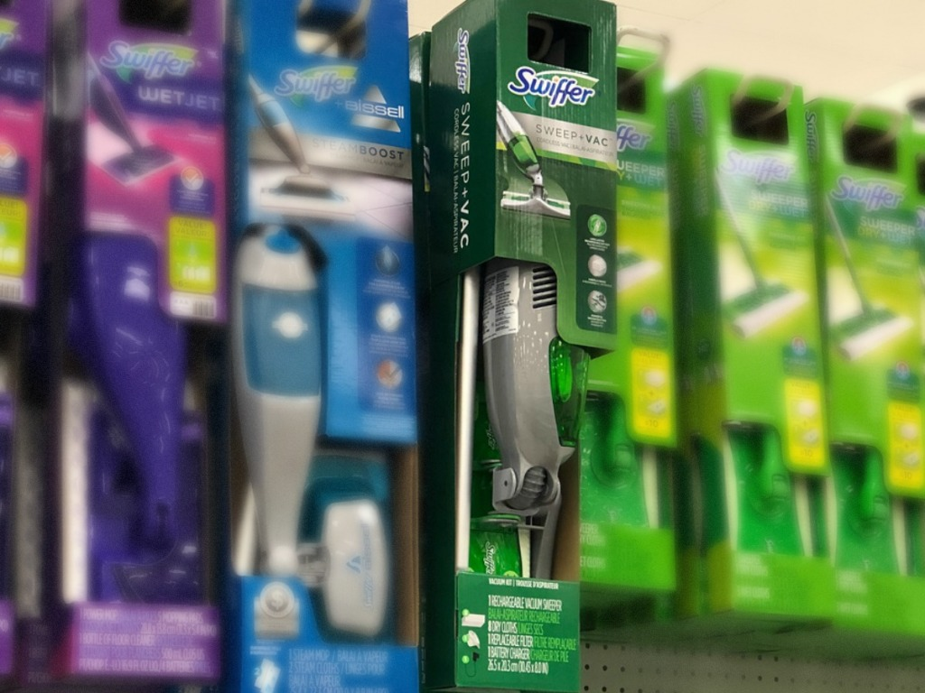 store display with swiffer vacuums hanging up on shelf