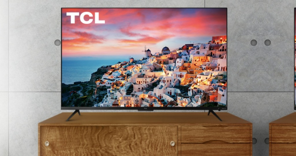 """TCL 50"""" Smart 4K UHD TV on tv console"""