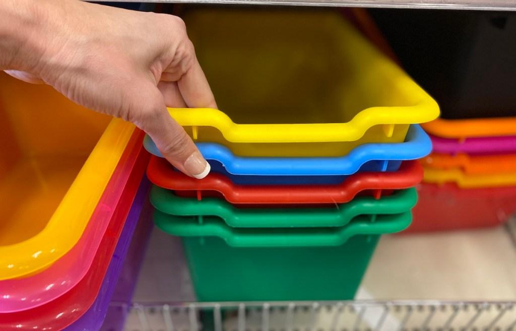hand holding plastic storage bins at Target