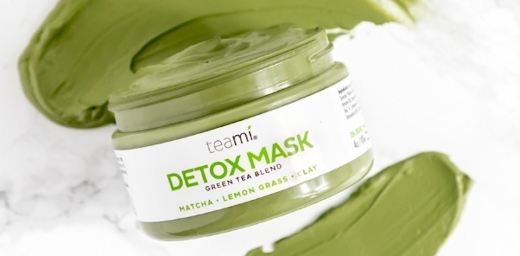 Teami Green Tea Blend Detox Mask jar with product smeared on counter