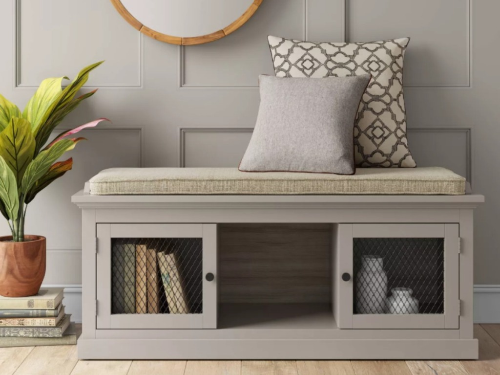 gray entryway bench with throw pillows on top