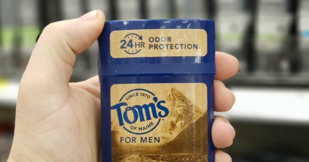hand holding Tom's of Maine Deodorant