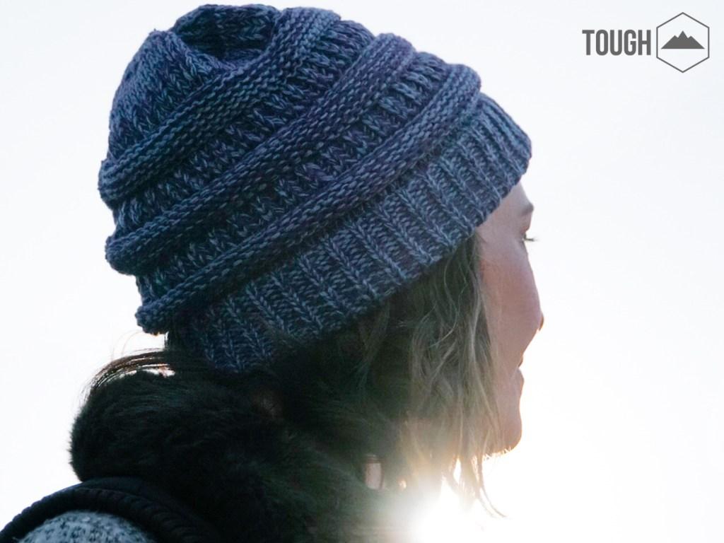 girl wearing blue tough headwear outdoors