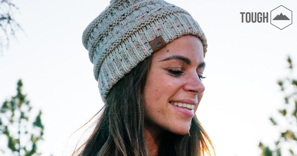 woman wearing brown tough headwear hat outdoors