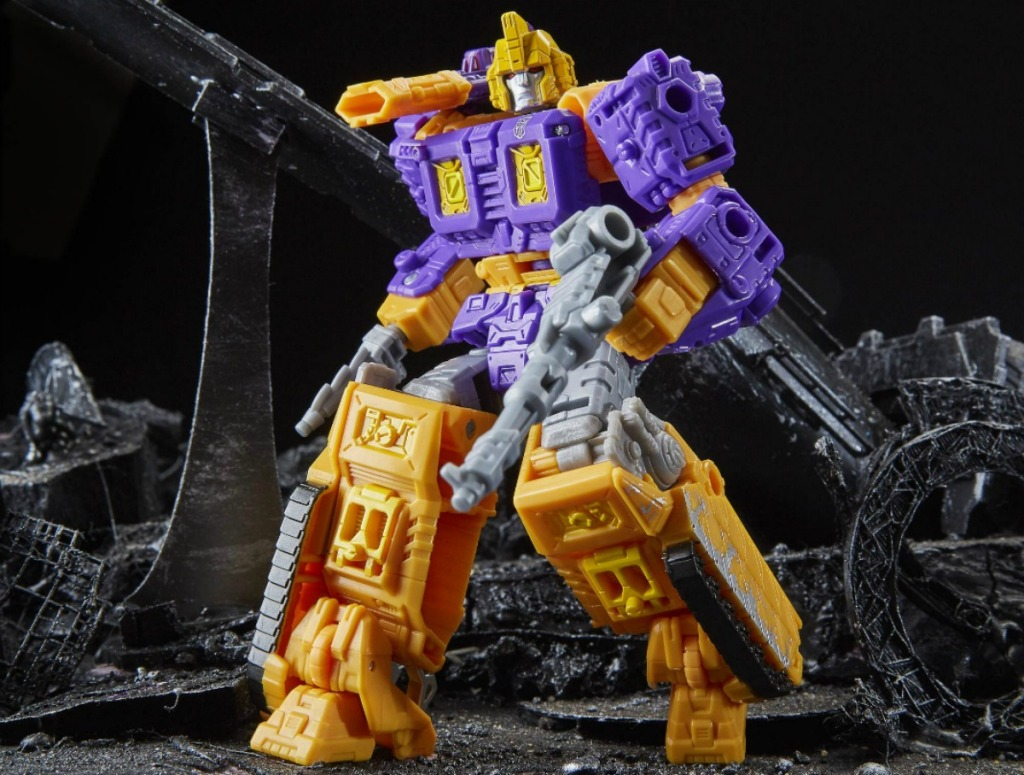 yellow and purple transformers toy standing