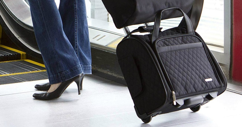 Woman walking with a wheeled carry on bag