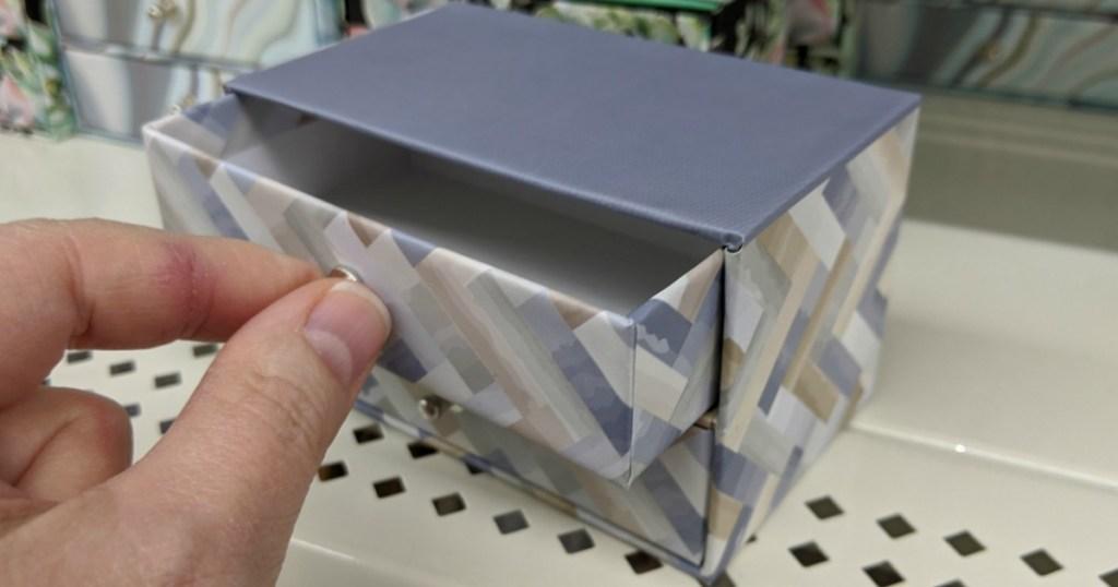 hand opening drawer of trinket box at Dollar Tree