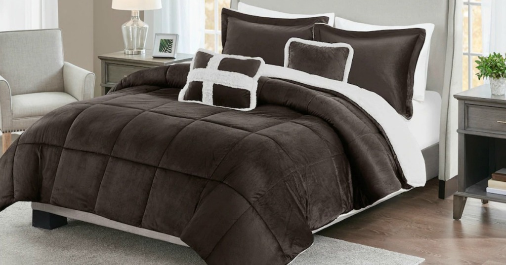 Brown reversible sherpa comforter on large bed