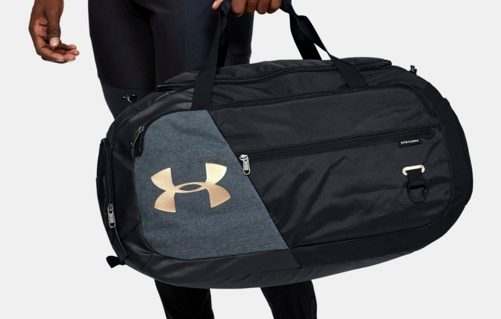 Man carrying Under Armour Duffel