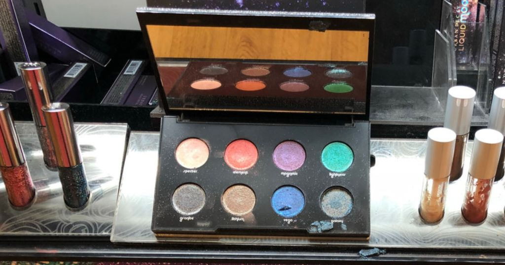 Urban Decay Moondust Eyeshadow Palette on display in store with lip products near by as well