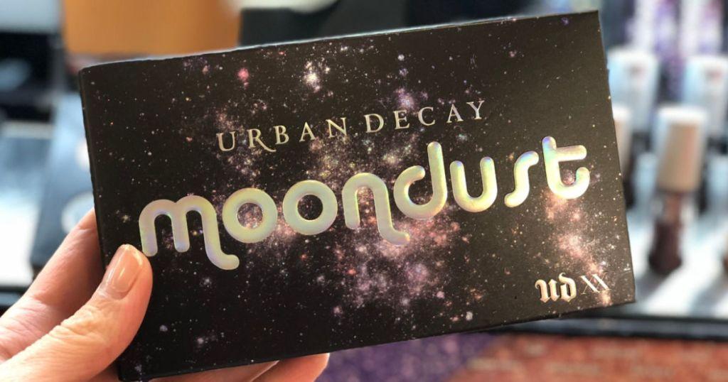 hand holding Urban Decay Moondust Eyeshadow Palette