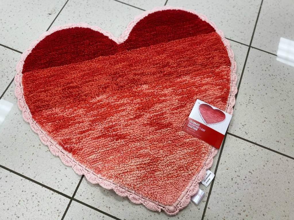 Valentine's Day themed heart shaped bath rug on store floor