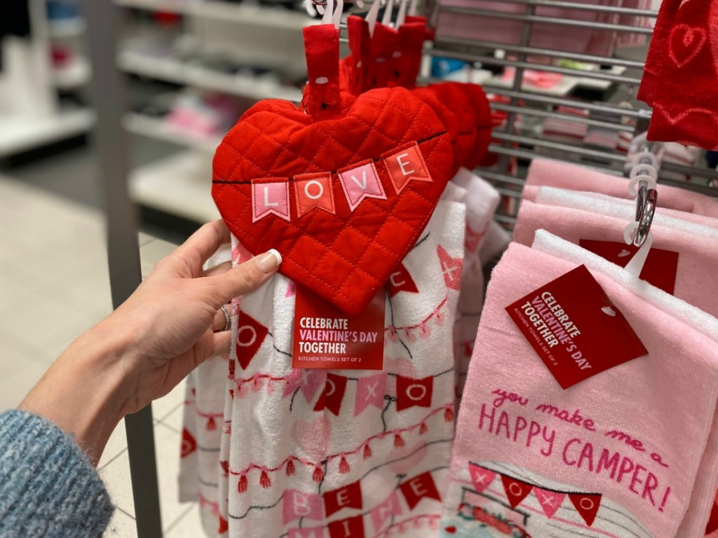 Valentine's Day themed kitchen towels on display in-store on rack