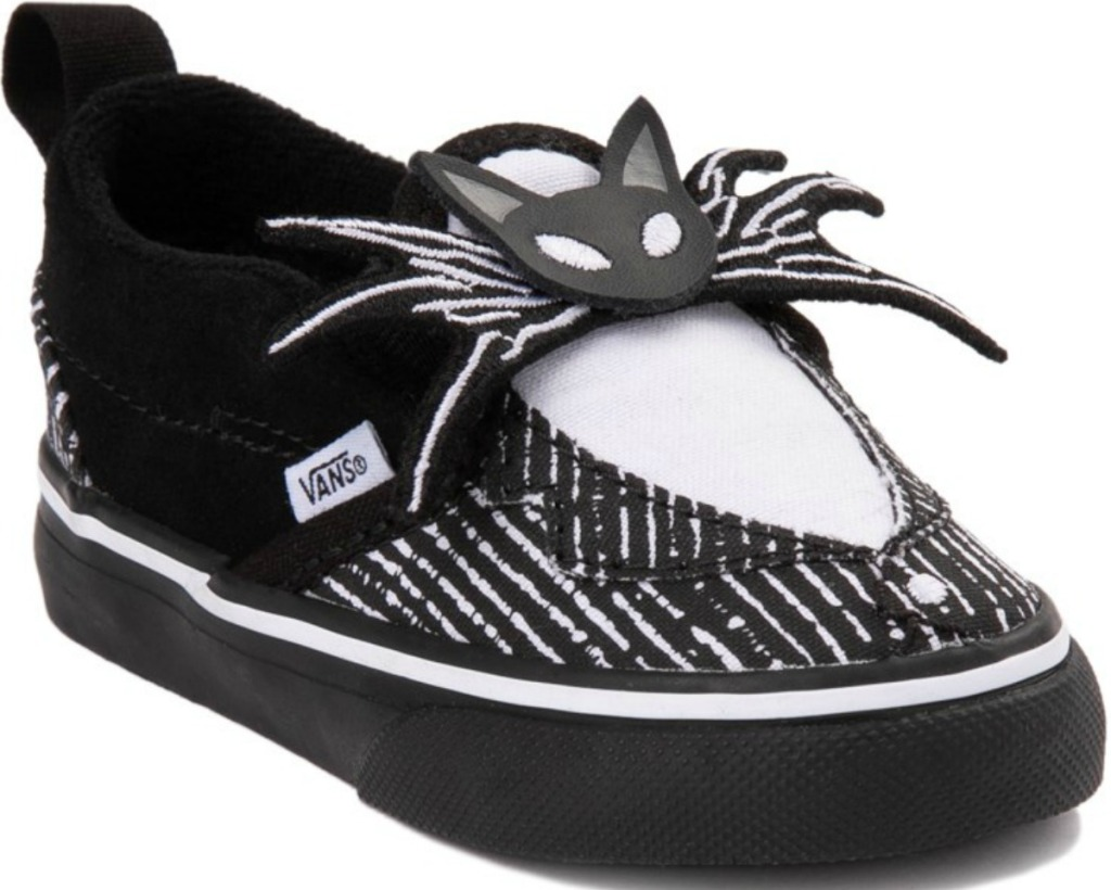 Slip on shoes in black and white skeleton theme