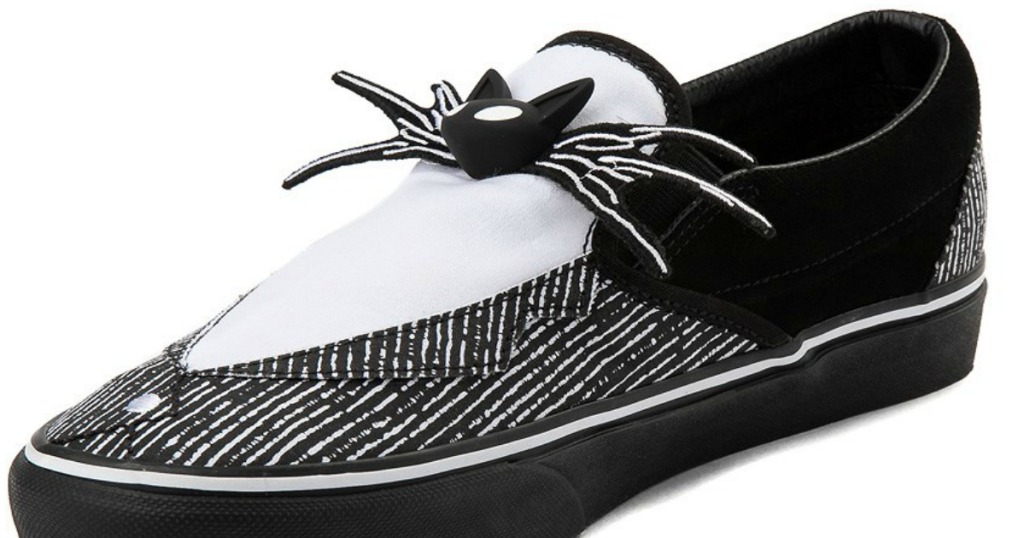 black shoe with cat and spider looking legs on as decoration