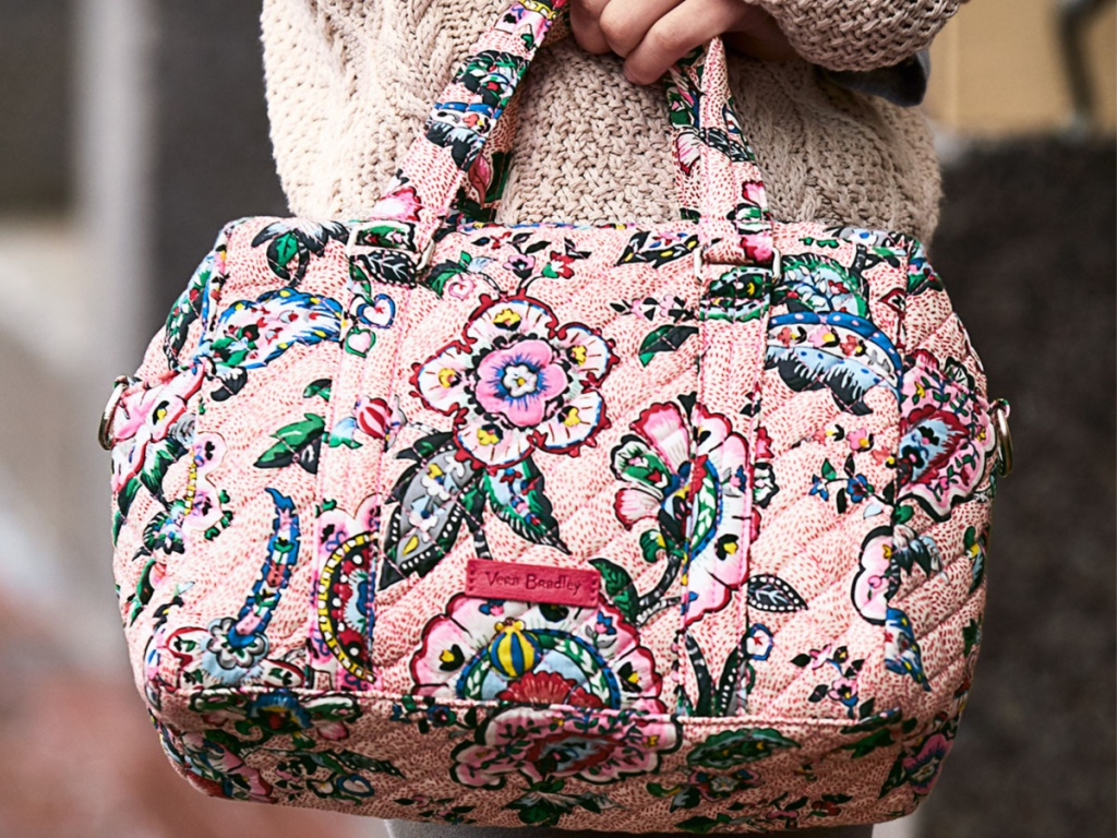 Vera Bradley 100 Handbag Stitched Flowers in woman's hand