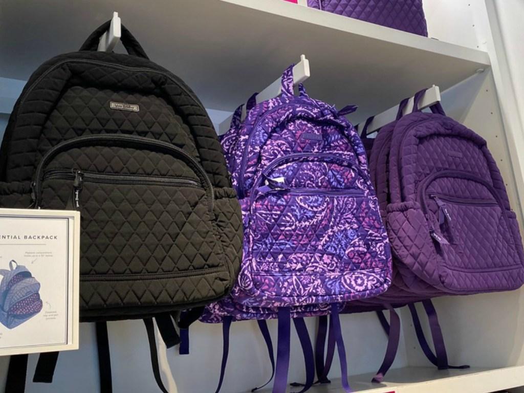 Vera Bradley backpacks hanging at the store