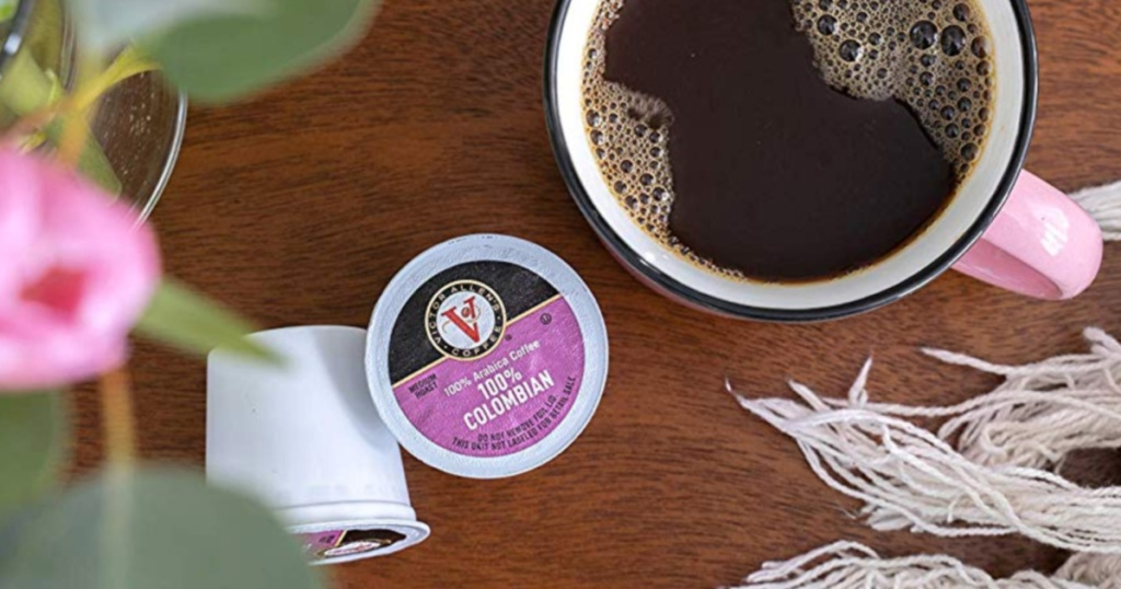 Victor Allen Coffee K-Cups with a cup of coffee