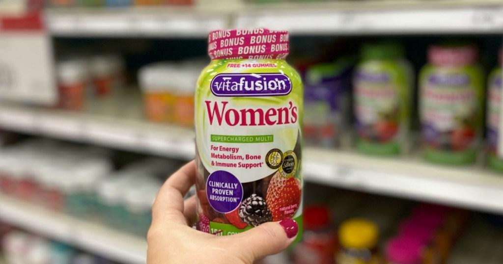 Woman holding Vitafusion Women's Gummies