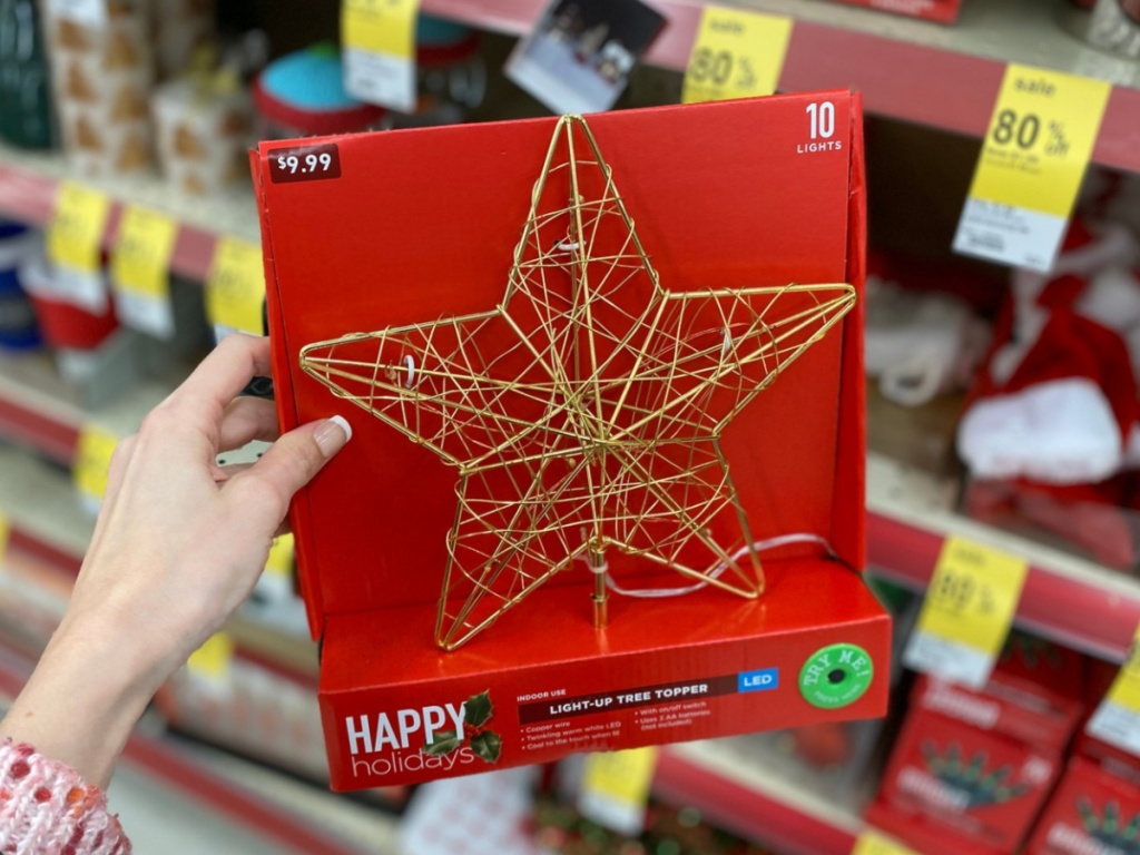 Hand holding Walgreens holiday tree topper