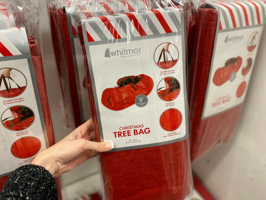 hand holding package of Christmas tree storage bag