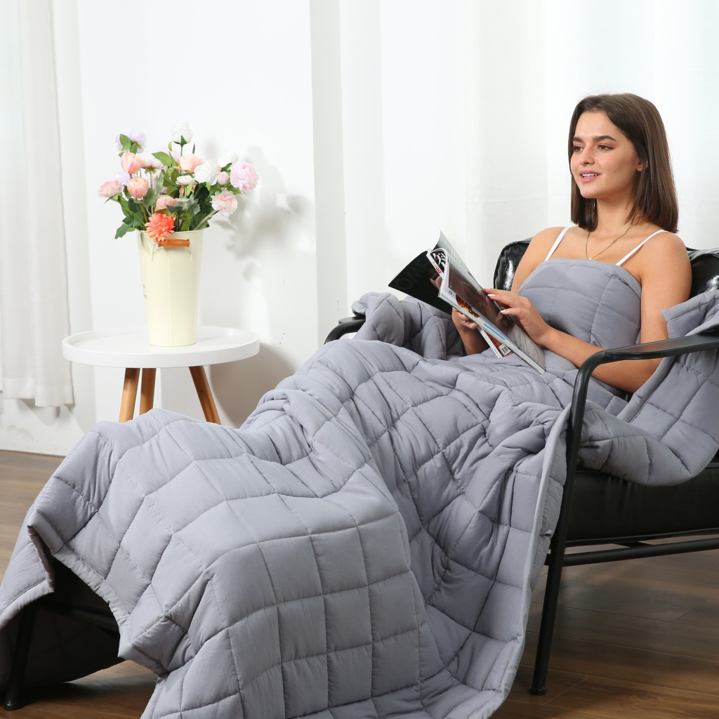 Woman with Sleep Mantra Weighted Blanket