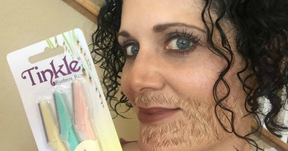 Woman with fake beard holding tinkle dermaplane