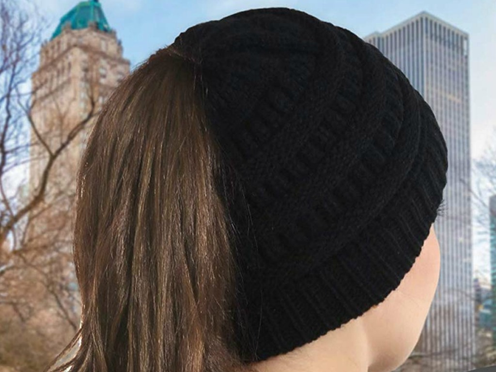 Woman wearing a cable knit beanie hat outdoors