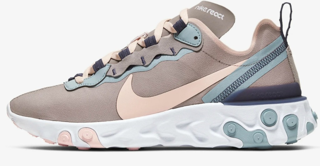Women's Nike brand shoe in beige with pink and light blue accents