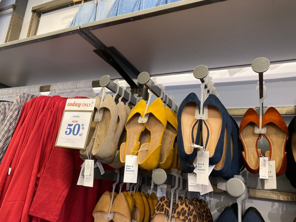 old navy womens slip on dress shoes in navy, yellow, and tan with sale sign in store