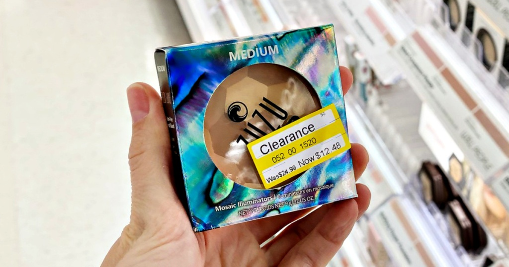 Zuzu Luxe Mosaic Illuminator in hand at Target with clearance sticker