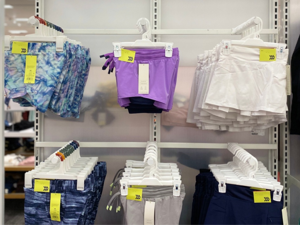 girls all in motion shorts hanging on wall in store