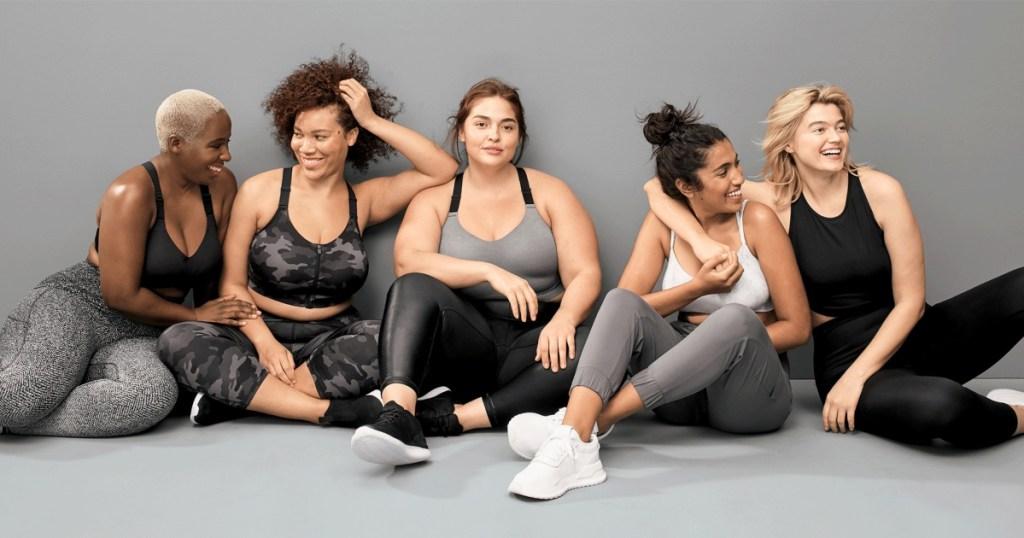 five women wearing athletic apparel