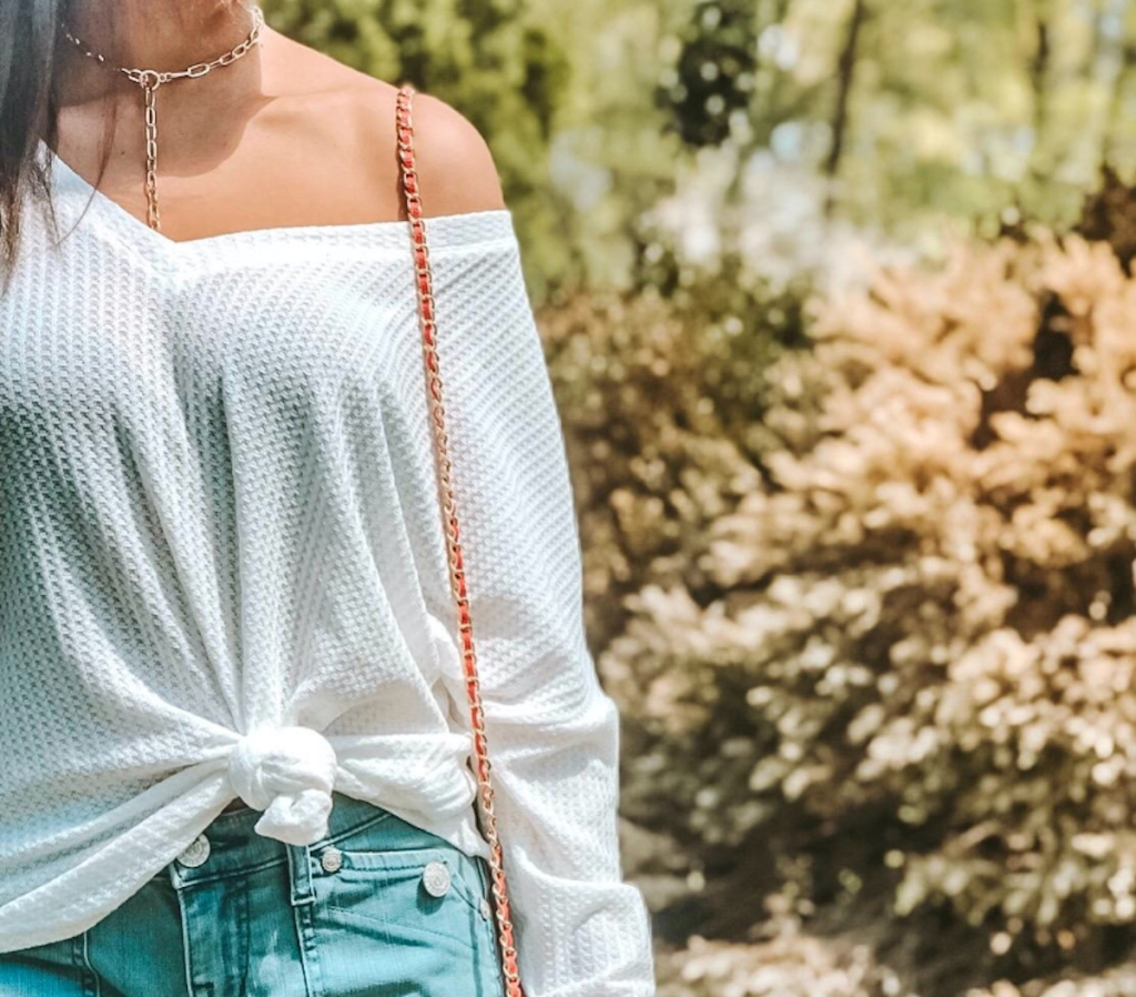 woman wearing white waffle knit shirt tied in the front