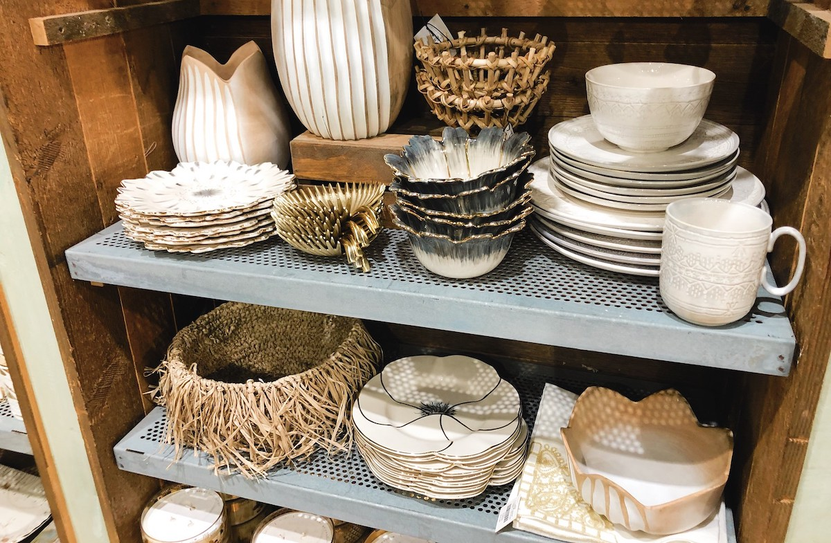 store shelves with neutral dishes and baskets