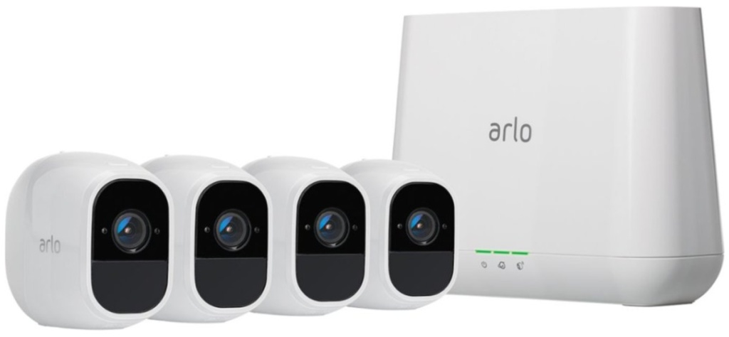 four arlo security cameras and adapter