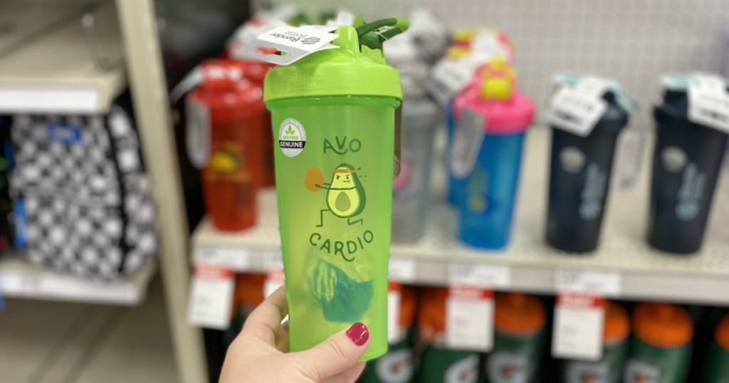 green cup with exercising avocado held in store