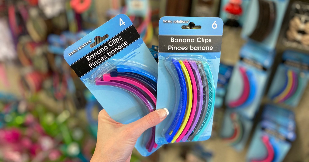 hand holding 4-pack and 6-pack of banana clips in store