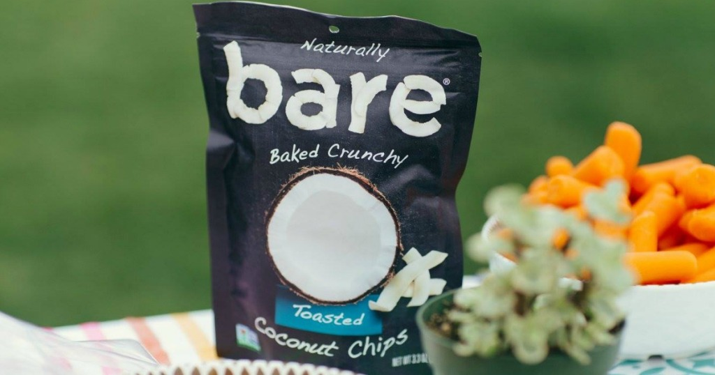 bare coconut chips next to flowers sitting on a table