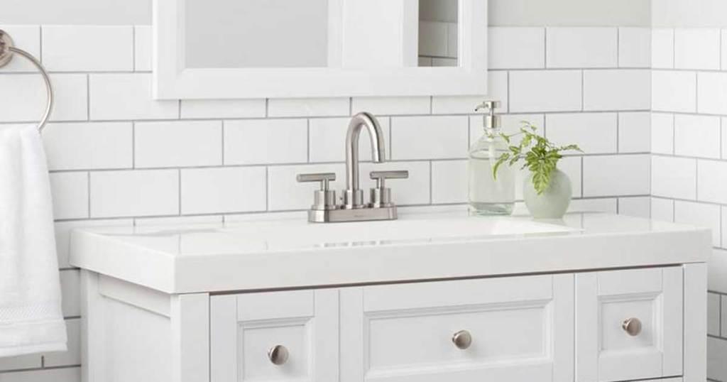 bathroom vanity and sink with Dorset Centerset 2-Handle Bathroom Faucet in Brushed Nickel featured