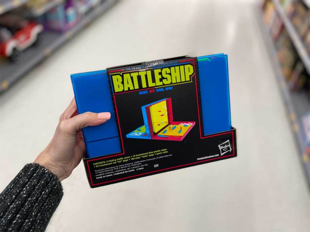 woman holding battleship neon pop game