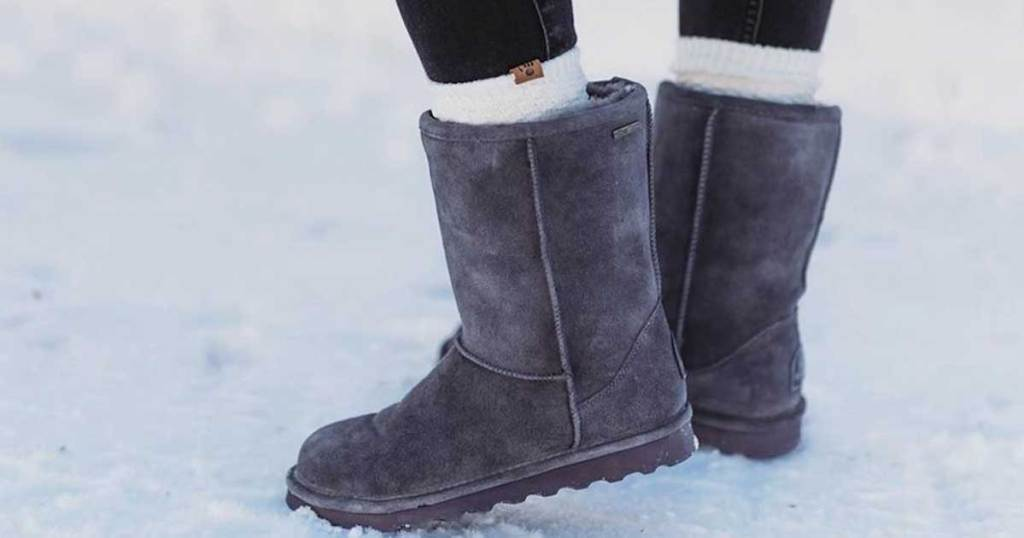 woman wearing bearpaw boots in the snow